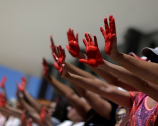 Demonstrators attend a protest against rape and violence against women in Brasilia