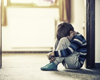 depressed-little-boy-sitting-on-the-floor-471031808-5956c2045f9b58843f183dcf